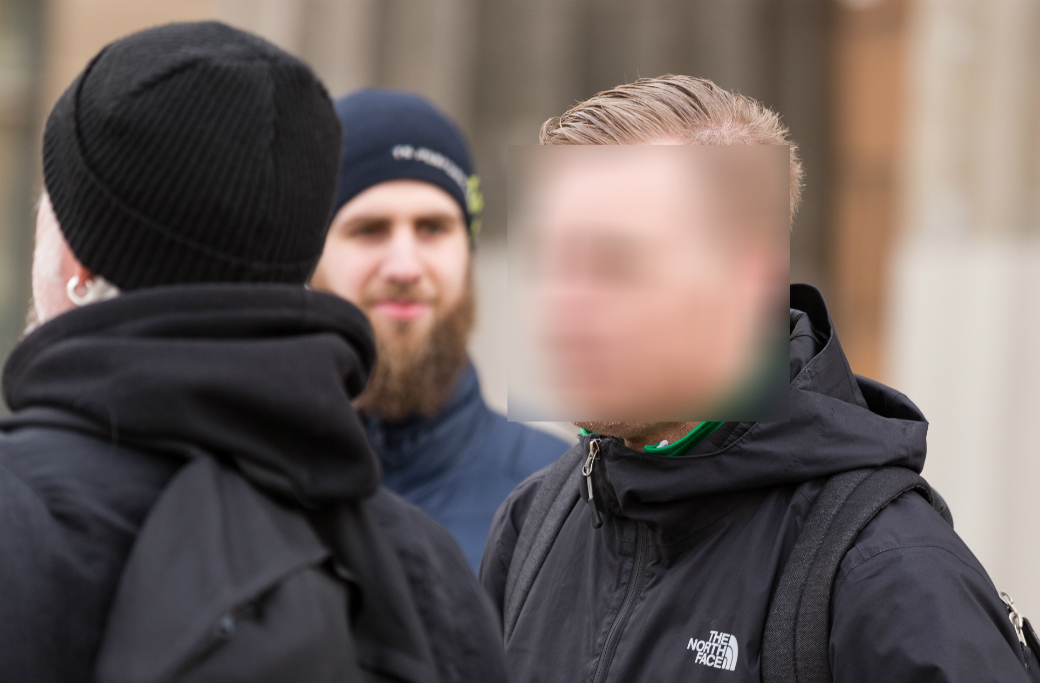 Den åtalade aktivisten i samband med en manifestation med Mynttorgsaktivisterna tidigare i år.
